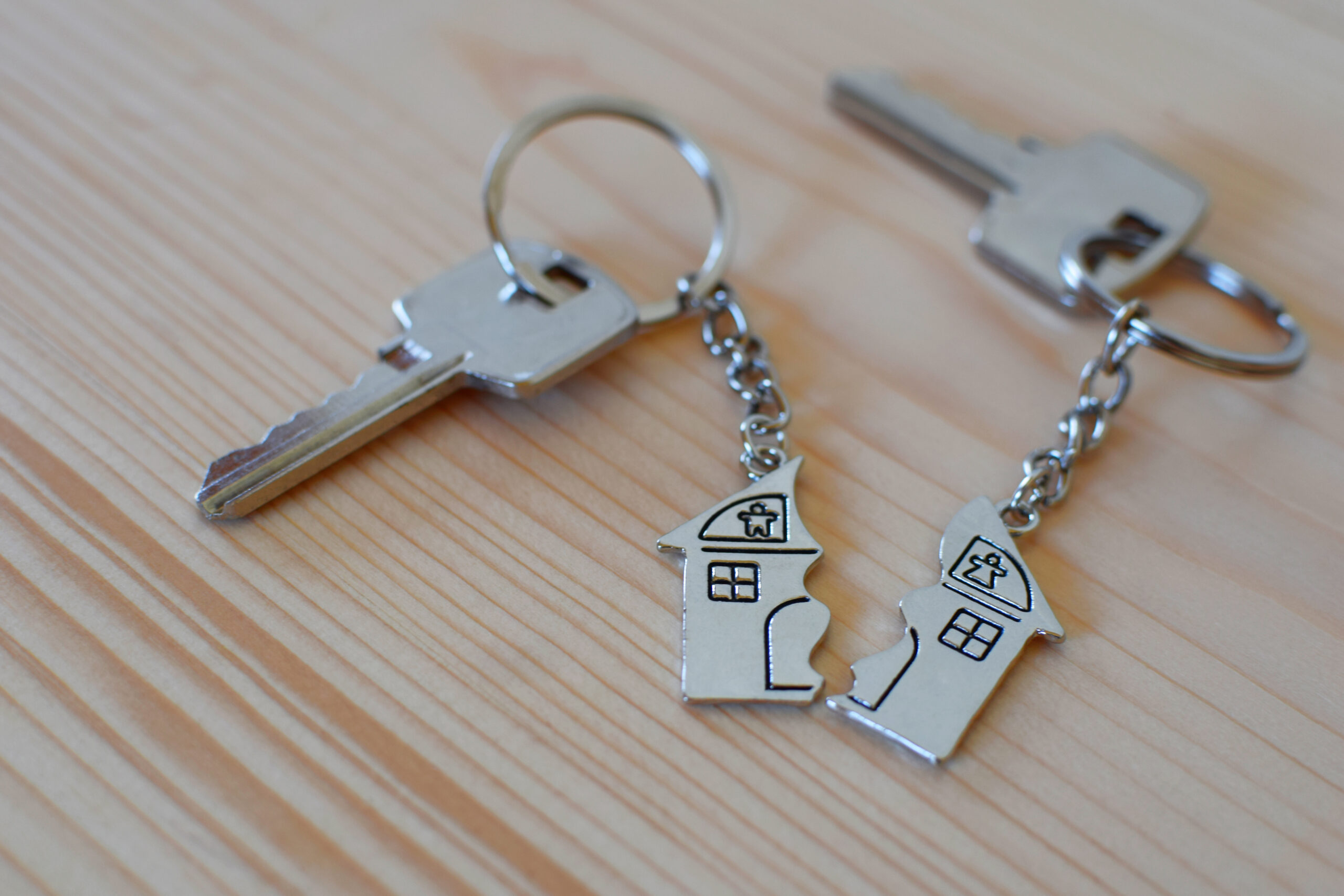 Pendant,Of,Key,Ring,In,Shape,Of,House,Divided,In