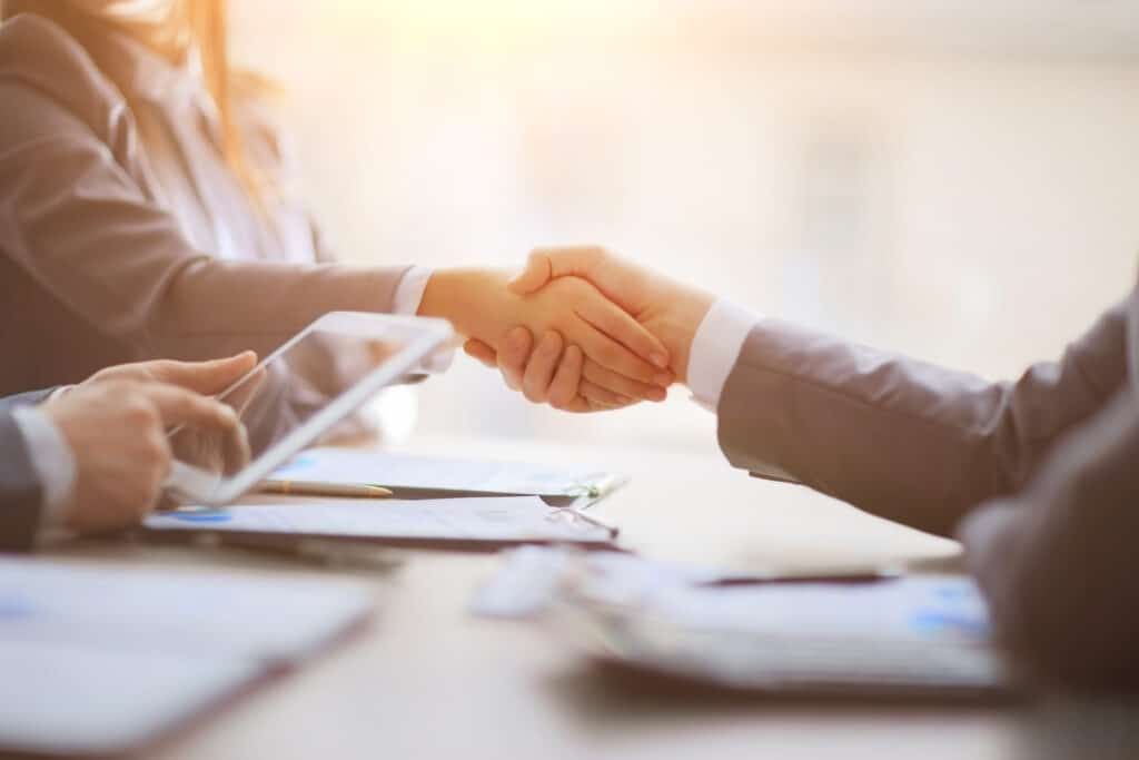Handshake,Of,Business,People,At,The,Negotiating,Table.,Close,Up.