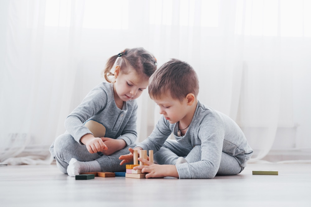 Children,Play,With,A,Toy,Designer,On,The,Floor,Of