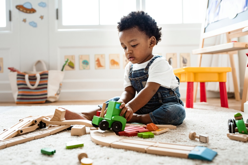 Cute,Little,Boy,Playing,With,A,Railroad,Train,Toy