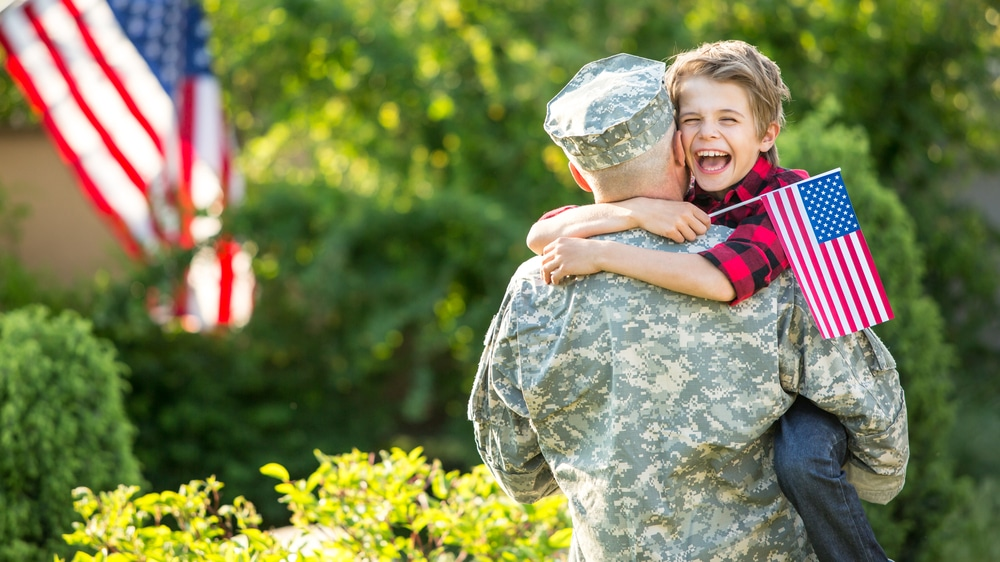 Happy,Reunion,Of,Soldier,With,Family,,Son,Hug,Father